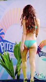 One of the contestant girls poses in a blue bikini — Stock Photo
