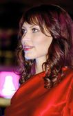 Brunette contestant in a purpre dress — Stock Photo