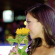 Contestant smells flowers — Stock Photo #13710045