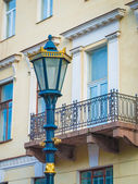 Lamp post in front of the balcony — Foto Stock