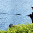 Man is fishing in the lake — Photo