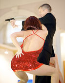 Man and woman dance for SONY company and promote James Bond new movie — Stock Photo