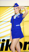 Girl wears a stewardess costume and poses at the Nikon stand — Stock Photo
