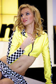 Sexual blond poses at the NIKON stand — Stock Photo