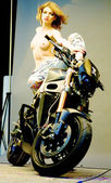 Semi naked girl poses near a motorbike — ストック写真