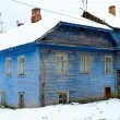 Blue old house in winter in Russia — Stock Photo
