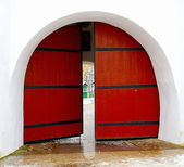 Red door to the monastery — Stock Photo
