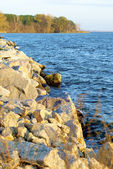 Stones on the coast of the river and the small island futher — Stock Photo