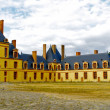 Panoramic view of the Castle Fontainebleau and its garden — Stock Photo #14665735