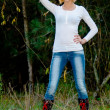 Caucasian model poses in a hat and jeans in the forest — Stock Photo