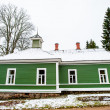 Green house in the village Mihaylovskoe in winter — Stock Photo #14736621