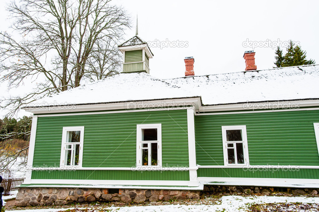 Green house in the village Mihaylovskoe in winter — Stock Photo #14736665