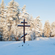 Wooden christ in the forest in Russia in winter - Stock Photo