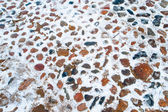 Road of different color stones in winter — Stock Photo