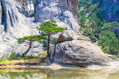 Bottom of the rock formation and a lake on the Mount Kumgang in — Stok fotoğraf
