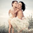 Happy mother and child hugging — Stock Photo #23990705
