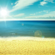 Summer beach with blue sea and sky in rays of sunlight. Happy vacation! — Stok fotoğraf