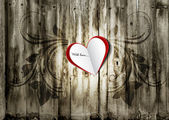 Valentine paper heart on a grunge wood background with floral ornament. Valentine's day card, background, greeting. — Stock Photo