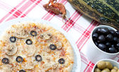 Pizza with black olives — Stock Photo