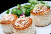 Puff pastry stuffed with mushrooms and salad — Stock Photo