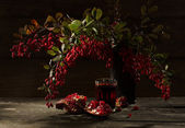 Pomegranate and barberry — Stock Photo