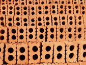 Roll of red orange soil bricks for construction — Stock Photo