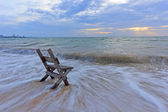 Chair on the sea sand with long speed shutter — Stock Photo