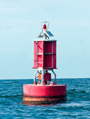 Floating red buoy at mid of sea — Stock Photo