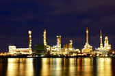 Oil refinery factory with reflection on the river. — Stock Photo