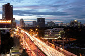 Blurs of night city traffic streams — Stock Photo