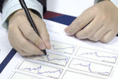 Bright picture of male doctor hands with cardiogram — Stock Photo