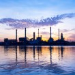 Oil refinery at sun rise time — Stock Photo