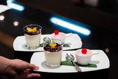 Smoothie yogurt and ice-cream with cherry maraschino on top — Stock Photo