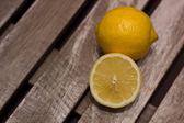 Fresh lemons on wooden table — Stock Photo