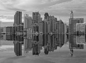 Building on Reflection on black and white scene at mid of city — Foto Stock
