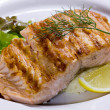Salmon steak grilled with lemon — Stock Photo