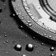 Hard disk drive with drops of water on it, close-up — Stock Photo