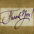 """Thank you"" handwritten calligraphy over old vintage paper background — Stock Photo"