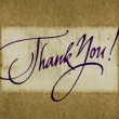 """Thank you"" handwritten calligraphy over old vintage paper background — Stock Photo #26415053"
