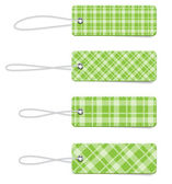 Green vector tartan fabric textured badges with straps — Stock Vector