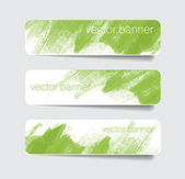 Green abstract paper banners - stickers - badges with hand painted brush strokes background — Stock Vector