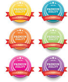 """Colorful round vector vintage badges collection """"Premium quality"""" decorated with red ribbons — Stock Vector"""