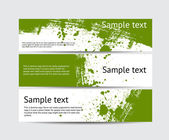 Set of green vector brush stroke hand painted banners with paint splatters — Stock Vector