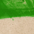 Green hand-painted brush stroke daub background over old vintage paper — Stock Photo