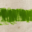 Green hand-painted brush stroke daub background — Stock Photo