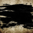 Black abstract hand-painted brush stroke daub over vintage grungy background — Stock Photo