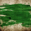Green abstract hand-painted brush stroke daub over vintage grungy stained old paper — Stock Photo