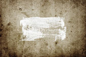 White abstract hand-painted brush stroke daub over vintage grungy stained old paper — Stock Photo