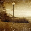 Distressed vintage grungy photo of lantern on a street — Stock Photo