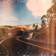 Distressed vintage grungy photo of a road in the mountains of Ecuador — Stock Photo